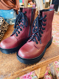 Lug Sole Boots are trendy and these Soda Firm Cherry Red Lug Combat Boots are your next pair of must-have booties! These Dr Marten Boot Look-a-likes lace up, have a side zipper, and a rubber lug sole! Pair them with all your fun fall looks! Multitudes Boutique. Cutest Online Boutique. Fall Combat Boots. Free Ship $75.