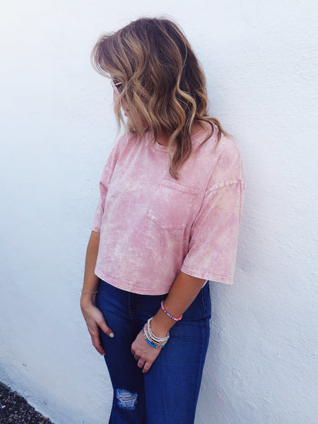 Are you looking for a fun Cropped Tee? Then you gotta grab this Pink Mineral Wash Cropped Tee! It's unbelievably soft and comfy, will look great with just about anything, and is an all around great basic! Trust us, you will want to live in this cute comfy cropped tee! Multitudes Boutique. Cutest Online Boutique.