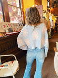 Cropped Knit Sweaters at Multitudes Boutique - The Blue Daisy for Days Sweater is adorable! This Cropped Sweater is marled knit, has a loose v-neck, and cuffed bell sleeves. The cutest thing about this Flower Sweater is the pink daisies all over it! Multitudes Boutique. Cutest Online Clothing Store.