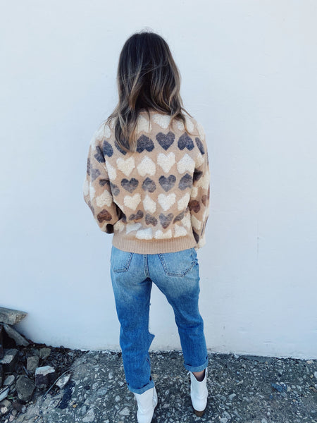 Are you searching for your next Cute Fall Sweater? Then grab this Textured Hearts Sweater! Girl, this Heart Sweater is the cutest sweater around. Pair this cute fall sweater with your favorite Distressed Mom Jeans and your white booties for an adorable fall look! Multitudes Boutique. Cutest Online Boutique.
