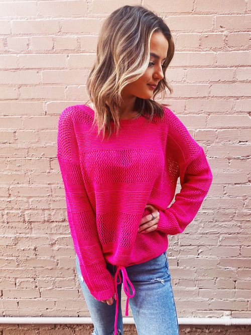 Open Knit Sweaters at Multitudes Boutique - The Hot Pink Sheer Beach Sweater is adorable! This Loose Knit Sweater has a stripped effect. This Beach Sweater is semi-sheer, has long sleeves, and drawstring. This Summer Sweater is perfect for your next vacay! Multitudes Boutique. Cutest Online Clothing Store.