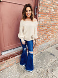 Cream Boatneck Sweater by Multitudes - This Oatmeal Ribbed Boatneck Sweater is the cutest Cream Sweater we've seen! We love the dolman styled sleeves, the ribbed knit going sideways, and that boatneck that can go on or off the shoulder. Multitudes Boutique. Cutest Online Boutique.