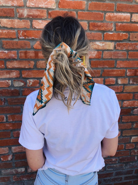 "Y'all, The Harper Wild Rag is the NEXT TRENDY ACCESSORY to add to your wardrobe!! This bandana sized scarf has a satin feel. Tie it up in your hair like we showed here, or tie it around your hat, your neck, your wrist, or your purse strap! The Harper Wild Rag will add a little zing to any outfit! 19.5"" x 19.5"" 100% Polyester. Best Online Boutique."