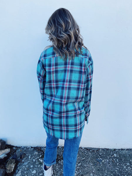 Plaid Flannel Shirt by Multitudes - This Classic Mint Plaid Boyfriend Flannel is one every closet needs! This women's flannel shirt is a bit oversized, is super soft, and has mint green, black, and a touch of pink in the plaid. Honeysuckle Tees. Multitudes Boutique. Cutest Online Boutique. Flannel Shirts for Women.
