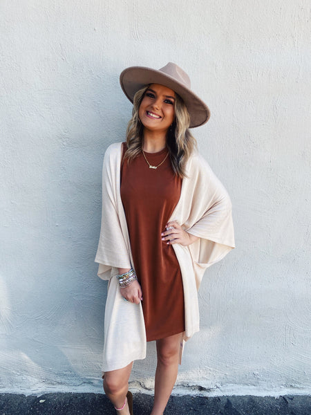 Looking for a Shift Dress to wear this fall? Then, snag this Camel Basic Shift Dress! Wear this jersey shift dress with sandals right now while it's warm, then layer it under your denim jacket or cardi when it gets cold! Multitudes Boutique. Cutest Online Boutique.