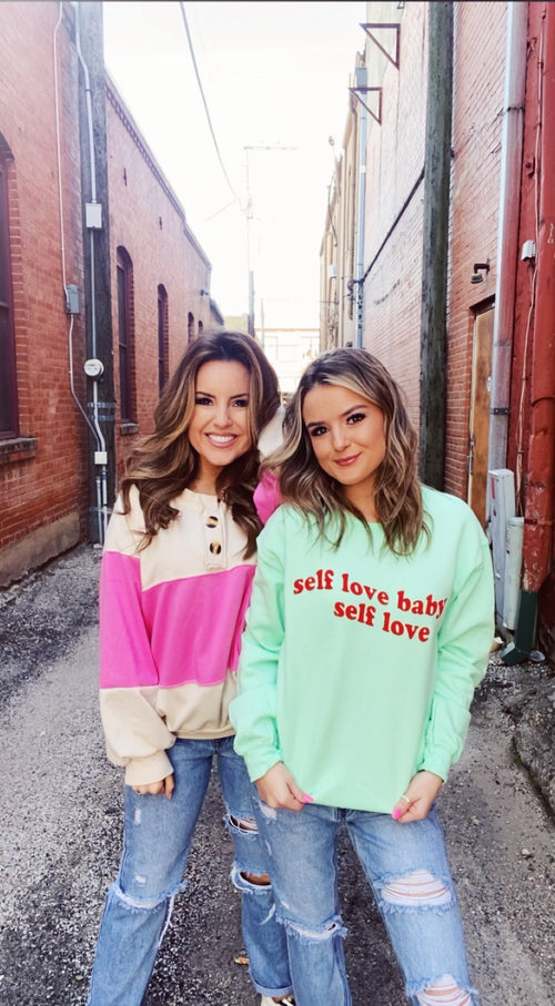 Self Love Club at Multitudes Boutique - The Self Love Sweatshirt is cute, comfy, and the graphic is TRUTH! This Empathy Sweatshirt is mint green with red lettering for a fun color combo. Selflove is so important. Wear this Self Love Sweatshirt this Valentine's Day. Multitudes Boutique. Cutest Online Clothing Store.