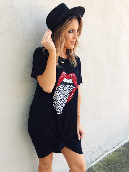 We just stocked the ever popular Leopard Tongue Graphic Tee, but on a t-shirt dress! Trust us, you HAVE to snag this Black Leopard Tongue Tee Dress! Pair it with your sneakers to run a few errands, or punch it up with a knot, a hat, and booties! Rolling Stones Tongue Tee. Multitudes Boutique. Cutest Online Boutique.