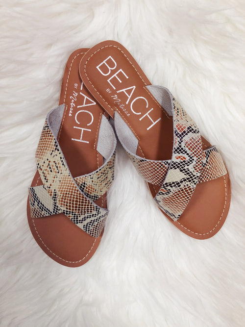 The Pebble White Snake Sandals by Matisse Coconuts, are a great new classic to add to your spring and summer wardrobe! Snakeskin is still trending, and we love this white, rust, and black mix. It will go with EVERYTHING! They are the NEW NEURAL! We also love the criss-cross style. They are so easy to slide in and slide out of and are also super comfy! Trust us, you will wear these on repeat all season long! The Pebble is an essential slide sandal with two criss-cross straps. Best Online Boutique.