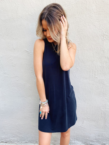 Shift Dresses are a classic, and you need to grab this Black Basic Shift Dress asap! You'll wear this jersey dress often and create the cutest fall transitional outfits around it, you'll wonder what you'd do without it! Trust us, you NEED this shift dress! Multitudes Boutique. Cutest Online Boutique.