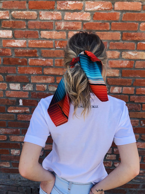 "Y'all, The Brooke Wild Rag is the NEXT TRENDY ACCESSORY to add to your wardrobe!! This bandana sized scarf has a satin feel. Tie it up in your hair like we showed here, or tie it around your hat, your neck, your wrist, or your purse strap! The Brooke Wild Rag will add a little zing to any outfit! 19.5"" x 19.5"" 100% Polyester. Best Online Boutique."