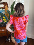 Sleeveless Ruffle Tops at Multitudes Boutique - The Carson Pink Jungle Ruffle Top is adorable! This Ruffle Sleeve Top is made of a tropical print in hot pink and orange! This Colorful Top has a keyhole button back, can be front tucked, and has ruffles on each shoulder. Multitudes Boutique. Cutest Online Clothing Store.