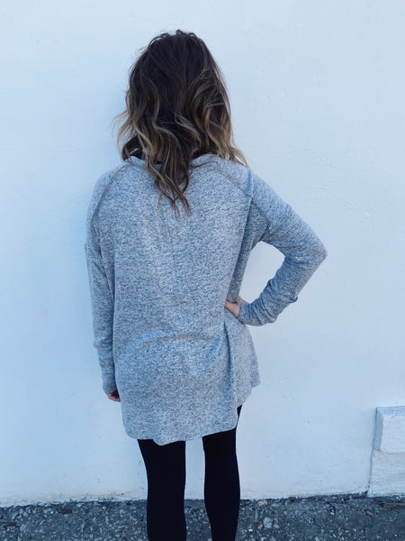 Tunic Top for Leggings at Multitudes Boutique - The Heather Grey Exposed Seam Top is an amazing lounge top! It is the softest top we have ever felt, and that heather grey is a classic. This Tunic Top has exposed seams and a pleat in the back to add a little fullness. Multitudes Boutique. Cutest Online Boutique.