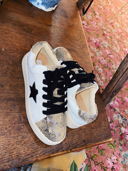 The Miracle Miles Rowan Star Sneaker is your next street-ready sneaker with all the fun details. The Flat laces lend a modern vibe, while the thick padded foot-bed guarantees all day comfort! Star and Snake Skin Detailing. The Miracle Mile Rowan Sneaker at Multitudes. Multitudes Boutique. Cutest Online Boutique.