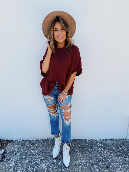 Are you looking for cute Fall Transitional Tops? Then, check out this Red Bean Gauze Poncho Top! Warm Fall days call for tops like this Gauze Poncho Top! Simply front tuck it into your favorite jeans with sandals now, then trade those sandals for booties for an early fall look. Multitudes Boutique. Cutest Online Boutique.