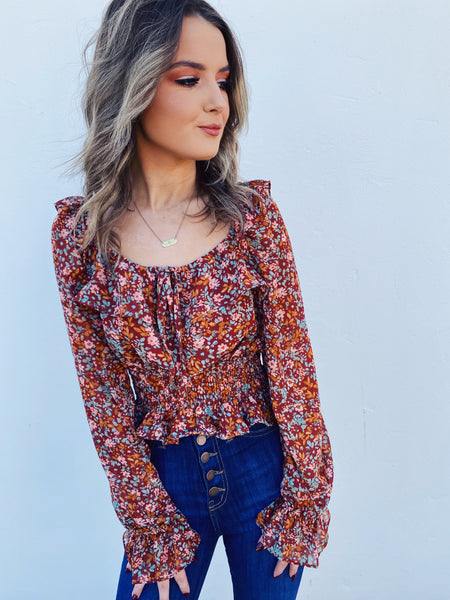 Square Neck Tops at Multitudes - The Warm Floral Cropped Peasant Top is the perfect new fall top to add to your closet! This Peasant Crop Top has a smocked waist. Square Neck Lantern Sleeve Top. Puff Sleeve Crop Top. Floral Print Peasant Top. Square Neck Crop Top. Multitudes Boutique. Cutest Online Boutique.