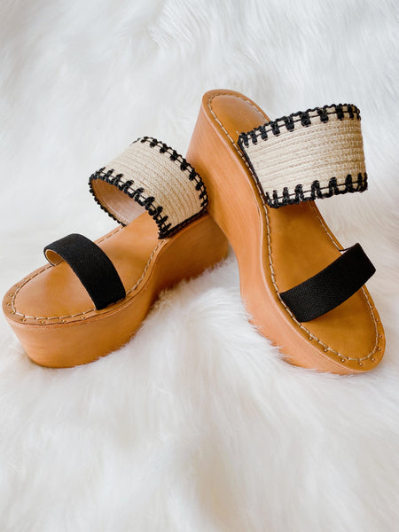A color-blocked, woven design accentuates the Wind Jute Linen Platform Sandal by Chinese Laundry. These Platform Sandals will offer a refreshing look to your summer shoes. Wear these Wedge Sandals with all your summer shorts, pants & dresses. Multitudes Boutique. Cutest Online Clothing Store.