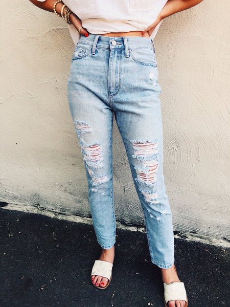 Looking for a pair of Destroyed Boyfriend Jeans? Then check out these Light Wash Destroyed Boyfriend Jeans! They are high waisted so they will look great with all your cute crop tops this summer, and all your cropped sweaters this fall! Snag 'em! You'll love how these fit! Multitudes Boutique. Cutest Online Boutique.