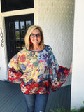 Mixed Print Kimono Style Tops are a fun addition to any closet, and this one is our favorite! It's stunning! Those blue, yellow, and red floral prints just make this kimono style blouse pop! This oversized top is semi-sheer, but a cami underneath is an option. Multitudes Boutique. Cutest Online Boutique.