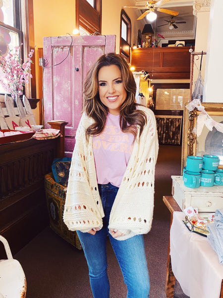 Lightweight Cardigans at Multitudes Boutique - The Natural Breeze Easy Cropped Cardigan is in style this season! This Loose Knit Sweater is cream and has stripes and breezy openings throughout. This Cream Cardigan is long sleeved and a bit shorter in length! Multitudes Boutique. Cutest Online Clothing Store.