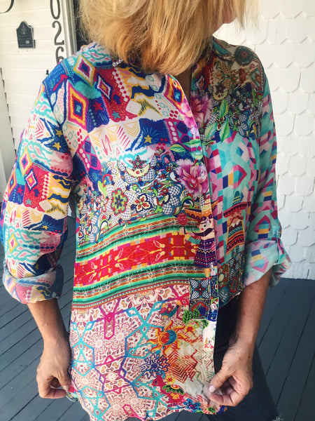 Love a Washed Silk Blouse? Check out the Mi Amiga Washed Silk Shirt! We're in Texas and love a Fiesta! From tex-mex to margaritas, to embroidery and tops with mini senors! Front tuck into your distressed jeans, add statement earrings, and you'll be the life of the party! Multitudes Boutique. Cutest Online Boutique.