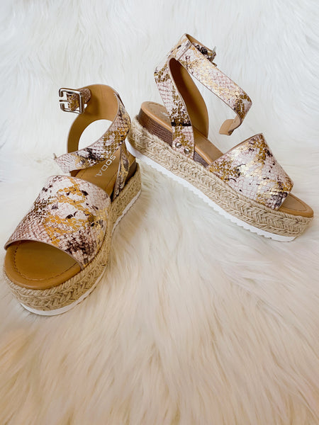 Flatform Espadrille Sandals at Multitudes Boutique - The Topic Metallic Snake Platform Sandal is a great basic! This Espadrille Platform Sandal has a jute base, a burlap look thick, and an ankle buckle strap. Wear these Platform Wedge Sandals on repeat! Multitudes Boutique. Cutest Online Clothing Store.