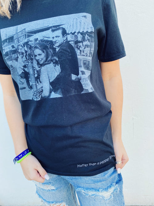 "Walk the Line Graphic Tee at Multitudes Boutique - Snag the Johnny and June Graphic Tee! An original picture of the iconic couple is printed on a black t-shirt. Along the hemline are the words, ""hotter than a pepper sprout"". Western Graphic Tee. Johnny and June Cash. Multitudes Boutique. Cutest Online Boutique."