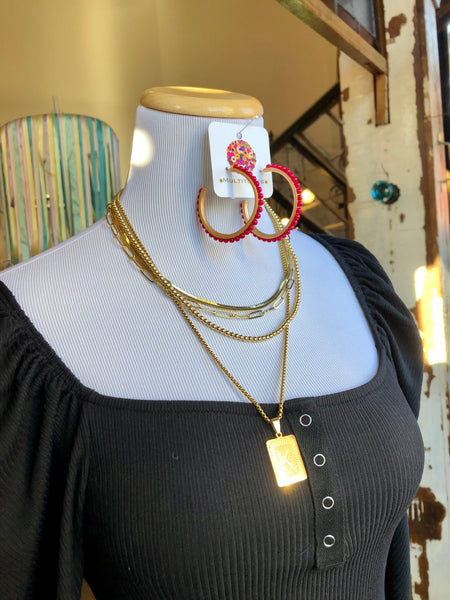 "Hoop Earrings with Beads at Multitudes Boutique - The Pink Winstead Earrings are a gold hoop earring with inlaid pink bead accents. They are lightweight and comfy and so versatile! 2.25"" surgical steel posts nickel and lead-free lightweight! Free Shipping over $75! Multitudes Boutique. Cutest Online Clothing Stores."