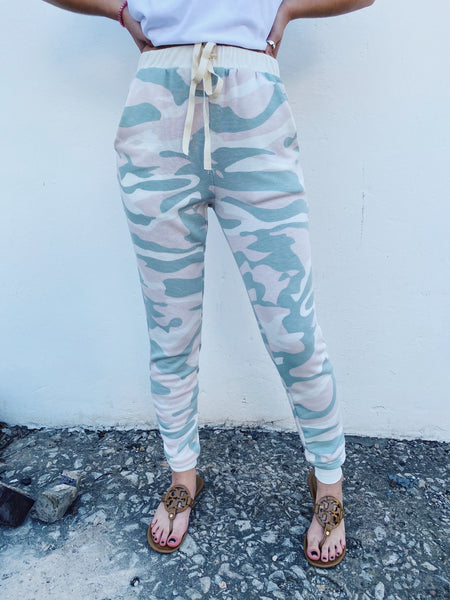 Looking for a new Lounge Set? Then score these Pink and Sage Camo Sweatpants which belong to our matching loungewear set! The pretty camo print is as soft as it is cute! Snag these Camo Joggers and the matching Camo Hoodie! You'll wear them on repeat! Multitudes Boutique. Cutest Online Boutique.