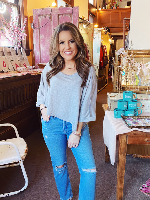 Distressed Mom Jeans at Multitudes Boutique - The Amy Mom Jeans are a MUST-HAVE for Spring! These High Rise Mom Jeans are lightwashed, have a straight fit, and hit at the ankle. These Lightwashed Mom Jeans have distressing on the thighs, slit knees, and frayed hem. Multitudes Boutique. Cutest Online Clothing Store.