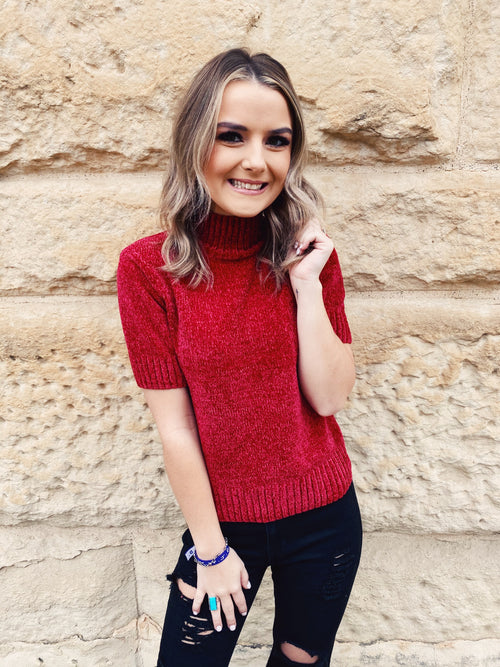 Short Sleeve Sweater at Multitudes Boutique - The Scarlet Chenille Short Sleeve Sweater is a classic! This Mock Neck Sweater is made of Deep Red Chenille! This Chenille Sweater has short sleeves and comes to the waistline. Multitudes Boutique. Cutest Online Clothing Store.