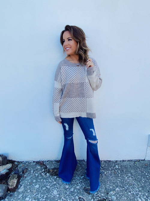 Cream Sweater at Multiudes Boutique - This Neutral Patterned Knit Sweater is a new classic! That pattern of taupe and cream is so classy! This beige sweater has a slight oversized fit and will keep you cozy and warm. Beige Sweater. Cream Sweater. Neutral Sweater. Multitudes Boutique. Cutest Online Boutique.