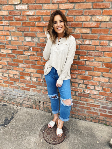 You will look adorable in this Henley Top! The Oatmeal Boyfriend Fit Henley Top will be your favorite whether you are wearing it out with flares and a flat brim, or whether you are lounging in it at home! Henley Top by Multitudes. Oversized Henley Top. Multitudes Boutique. Cutest Online Boutique. Free Shipping $75.
