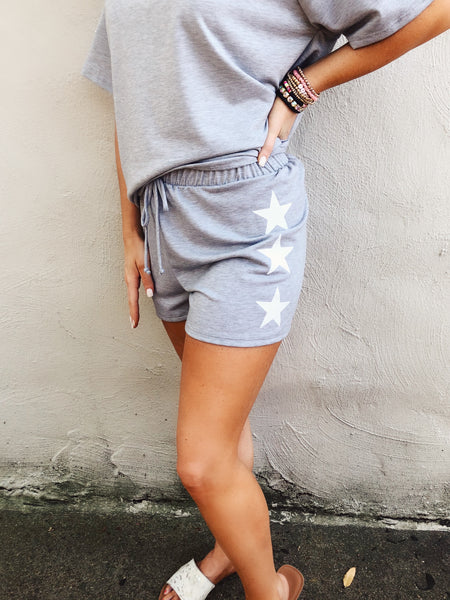 We love Two Piece Sets with Shorts, and these Grey Side Star Lounge Shorts are the bottom to our latest one. These lounge shorts are cute and comfy, and have stars down the sides! Not a Two Piece Set girl, then pair them with your favorite Honeysuckle Tee! Honeysuckle Tees. Multitudes Boutique. Cutest Online Boutique.