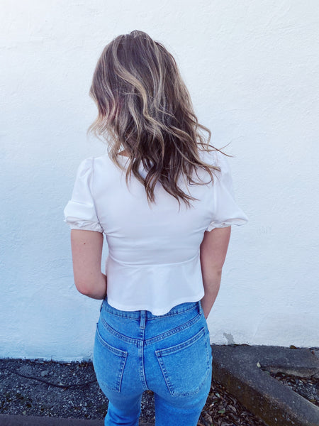 Sweetheart Neckline Tops at Multitudes Boutique - The White Lace Up Crop Top is a MUST-HAVE! This Short Sleeve White Crop Top has a lace up bodice, a peplum at the waist, a sweetheart neckline, and short puffed sleeves. This Lace Up Crop Top fits perfectly! Multitudes Boutique. Cutest Online Clothing Boutique.
