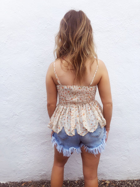 Girl, do ya need a Cute Summer Top? Then snag the Rust Ditsy Floral Peplum Top! It's the cutest thing we've seen! It has all the trendy details and fits like a dream! Pair it with your favorite distressed denim jean shorts and hit the road with the windows down! Multitudes Boutique. Cutest Online Boutique.