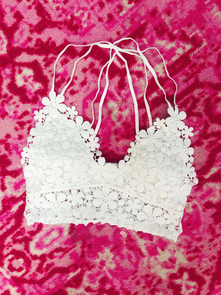 The  White Daisy Darling Bralette is the perfect way to add a little feminine flair to any outfit! We love the daisy lace detailing, the adjustable straps, and smocked back. This one is not only pretty, but it's super comfy as well. You can easily wear this underneath a sweater in the fall or a tank in the summer! The White Daisy Darling Bralette is a year-round essential! 90% Nylon, 10% Spandex Hand wash cold, Lay Flat to Dry Lace with lining and padding in bust