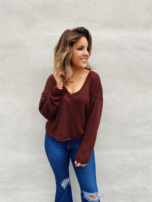 Looking for a long sleeve crop top? Then snag this Espresso Thermal Crop Top to wear all season long! Girl, this Waffle Knit Crop Top is your NEXT go-to top! You'll be able to wear this casual top with joggers, leggings & all your jeans! Trust us, you will LOVE this one! Multitudes Boutique. Cutest Online Boutique.