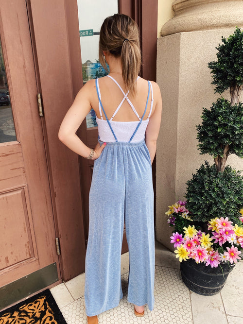 Wearing the Blue Skies Loose Jumpsuit will make you happy! Featuring wide legs, a loose waist, an elastic back, and adjustable straps, this Knit Jumpsuit will keep you cool and comfy! Pair this Wide Leg Jumpsuit with a white tee and sneakers for an adorable outfit! Multitudes Boutique. Cutest Online Clothing Store.