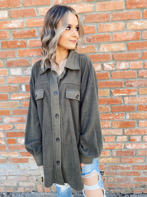 Women's Shacket at Multitudes Boutique - This Olive Oversized Shirt Jacket is the perfect shacket to add to your closet! That olive color is a great neutral, and this one is made of the softest, coziest fabric around! Shirt Jacket for Women. Shacket. Oversized Shacket. Multitudes Boutique. Cutest Online Boutique.