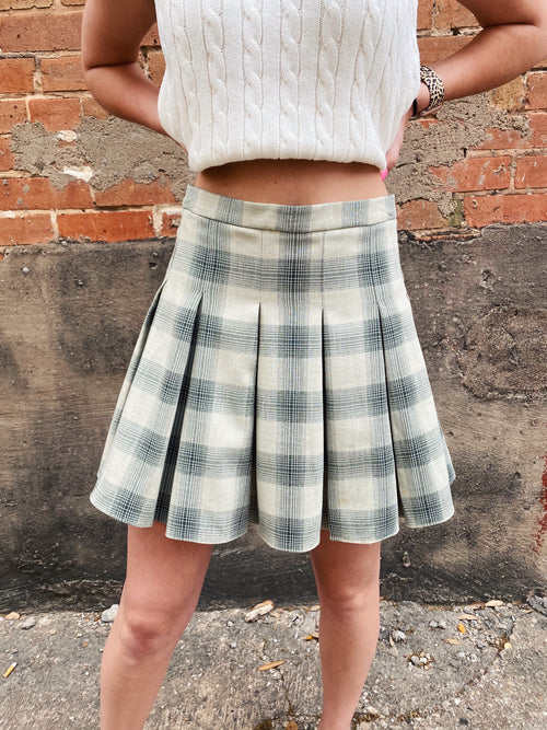 The Olive Plaid Skater Skirt is adorable! This Green Plaid Skirt features a high waistband, pleats, a zipper, and that olive tartan plaid. Pair this Pleated Skirt with your white bodysuit, sweater vest, or crop top for a fun preppy look! High Waisted Plaid Skirt. Multitudes Boutique. Cutest Online Clothing Store.