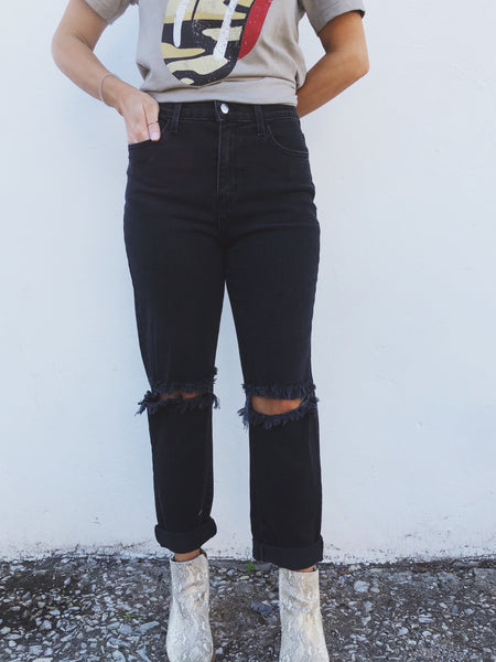 "We love the new fit of the Sloan Slit Knee Mom Jeans. They are high rise, have a slightly looser fit along the legs, and have exaggerated distressed cut-outs on the knees. They can be cuffed like we have them here to allow for your higher booties, or pulled down to wear with your mules. We love these jeans and will be wearing ours on repeat!  Hand Wash Cold, Hang to Dry  Mary is 5'4"" and wearing size 5."