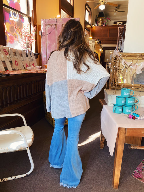Lightweight Sweaters at Multitudes Boutique - The Neutral Color Block Sweater is a great Oversized Sweater. This spring sweater is blocked in taupe, white, and grey in the front and the back and is super soft. This lightweight sweater has cuffs at the wrists. Multitudes Boutique. Cutest Online Clothing Store.