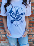 Rock Tees at Multitudes Boutique - The Woodstock Graphic Tee is printed in blue on a white 100% Cotton T Shirt. This Women's Graphic Tee is printed to look like a Vintage Grpahic Tee. This Rock and Roll Graphic Tee is a throwback. Multitudes Boutique. Cutest Online Clothing Store. Graphic Tees for Women.
