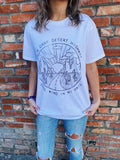 Rock Tees at Multitudes Boutique - The Dark Dessert Highway Graphic Tee is printed on a 100% White Cotton Tee so it is soft and will get better with wear. This Women's Graphic Tee is made to look like a Vintage Graphic Tee, and will become a new classic rock tee. Multitudes Boutique. Cutest Online Clothing Store.