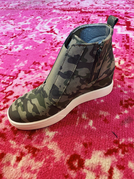 Hidden Wedge Sneakers are trending and we love these Raja Olive Camouflage Sneaker Wedges! The olive camo print is a classic and will look great with all your denim, athleisure, and loungewear joggers! You'll look so sporty and stylish when you wear these wedge sneakers! Multitudes Boutique. Cutest Online Boutique.