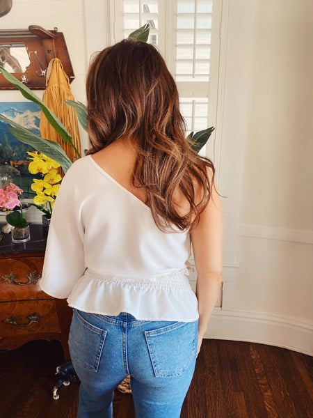 Off One Shoulder Tops at Multitudes Boutique - The Olivia Off One Shoulder top is adorable! This One Shoulder Blouse is white, has one dolman sleeve, an elastic waistband, and a small peplum. If you're looking for a Cute Top for Summer, this is definitely it! Multitudes Boutique. Cutest Online Clothing Store.