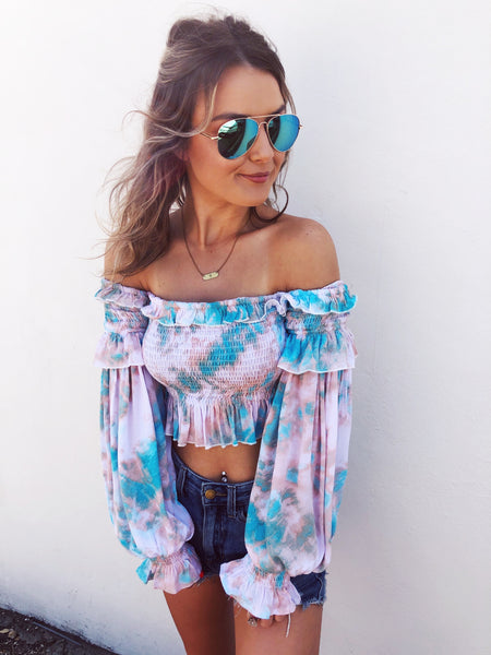 So you're a Smocked Top Crop Top Kinda Girl? Check out the Seaside Tie Dye Smocked Top! Girl, this Smocked Crop Top is the cutest we've EVER seen! Look at those colors! You know you need this one and will look absolutely adorable when you wear it on your next beach vacay! Multitudes Boutique. Cutest Online Boutique.