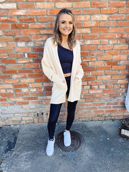 Knit Cardigan Sweater at Multitudes Boutique - The Cream Two Tone Knit Cardigan will be your go-to Knit Cardigan! This oversized chunky knit sweater has a basic weave in front, and a waffle style weave on the sleeves and back. This Oversized Knit Cardigan is a MUST! Multitudes Boutique. Cutest Online Clothing Store.