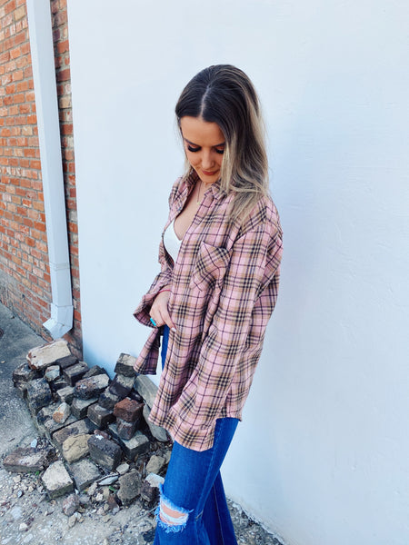 Oversized Flannels are a MUST for your closet and this Pink Plaid Boyfriend Flannel is perfect! This flannel shirt for women has an oversized fit, a retro and campy plaid look, is soft, and has a front pocket. Snag this oversized flannel before it's gone! Honeysuckle Tees. Multitudes Boutique. Cutest Online Boutique.
