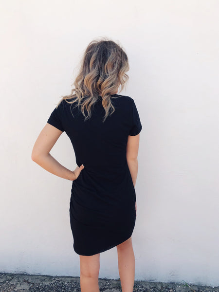 Looking for a great Bodycon T-shirt Dress? Then get the Black Ruched T-Shirt Dress! Ruched t-shirt dresses are trending and this Ruched T-Shirt Dress will be your favorite. Dress this LBD up or down. It's a great capsule wardrobe piece and will take you into the fall. Multitudes Boutique. Cutest Online Boutique.